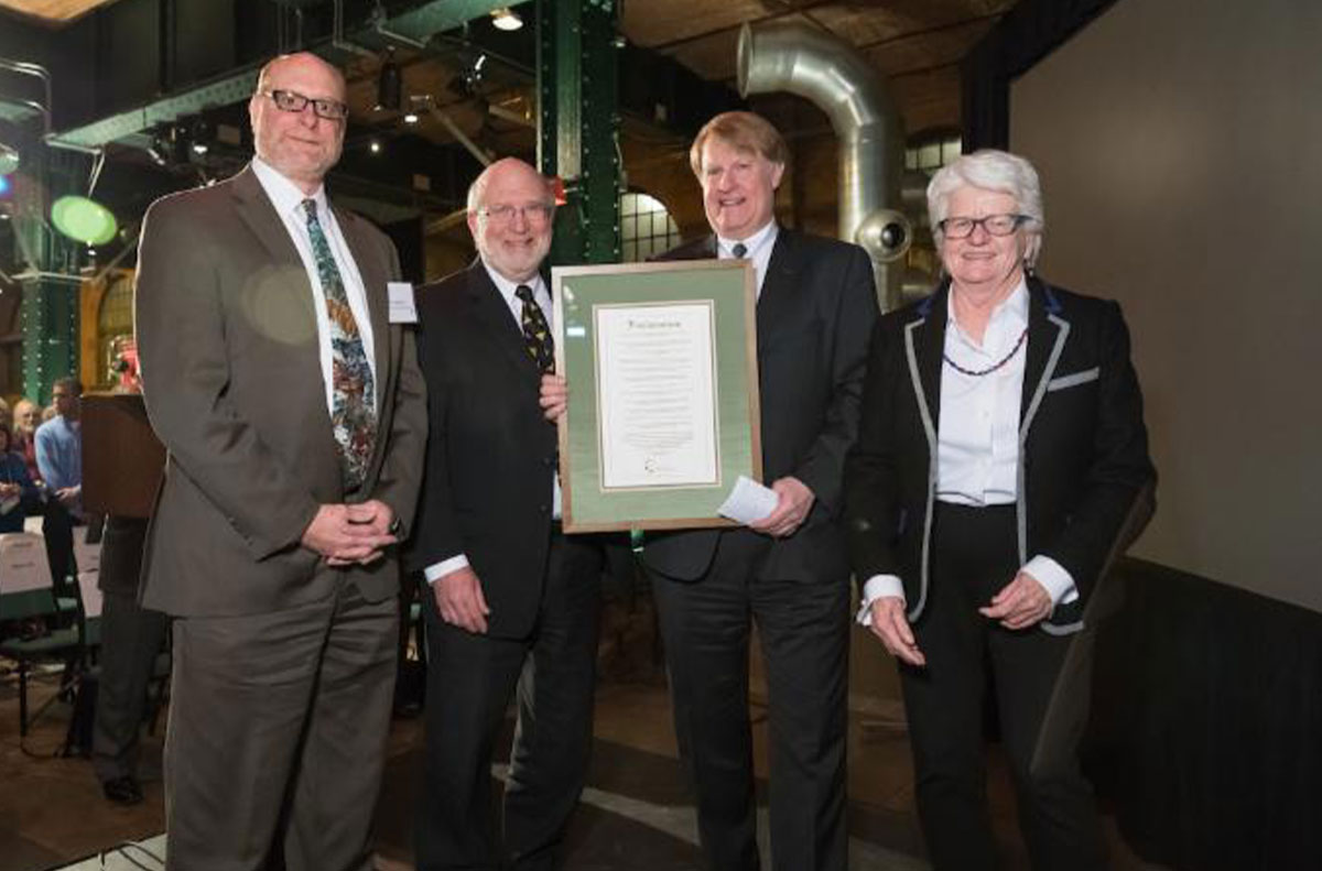 Allegheny County Executive Rich Fitzgerald displays a proclamation presented by the Allegheny County Parks Foundation for his sustained dedication to improvements in the nine Allegheny County Parks. (L to R) County Parks Director Andy Baechle, AC Parks Foundation Board Chairman Jim Mitnick and AC Parks Foundation Executive Director Caren Glotfelty.
