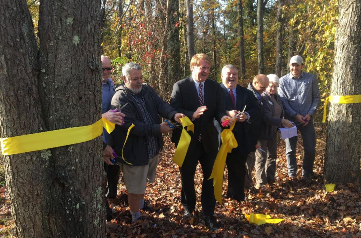 Ribbon cutting at Waterfall Trail Opens at Settlers Cabin Park