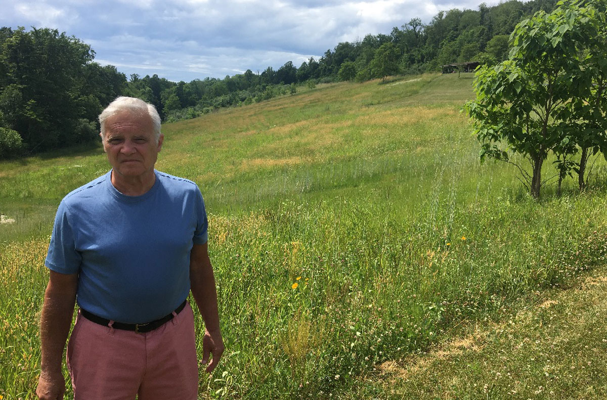 Man stands in front of Meadow